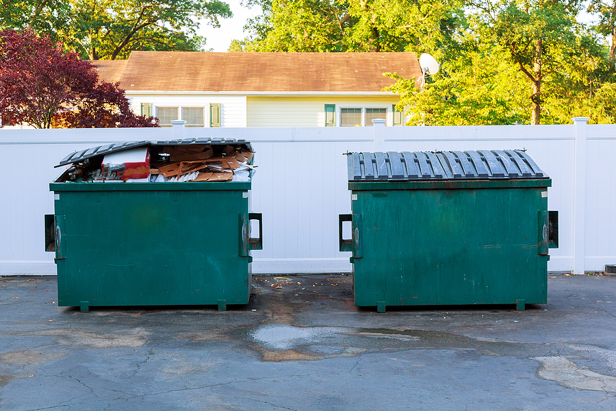 Dumpsters being full with garbage container Over flowing